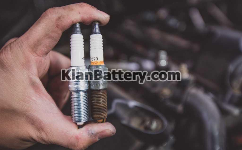changing a spark plug 2 1024x638 علائم خرابی شمع ماشین و تشخیص آن در خودرو